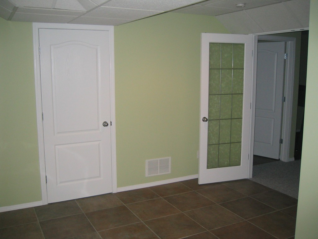 renovated basement with green walls