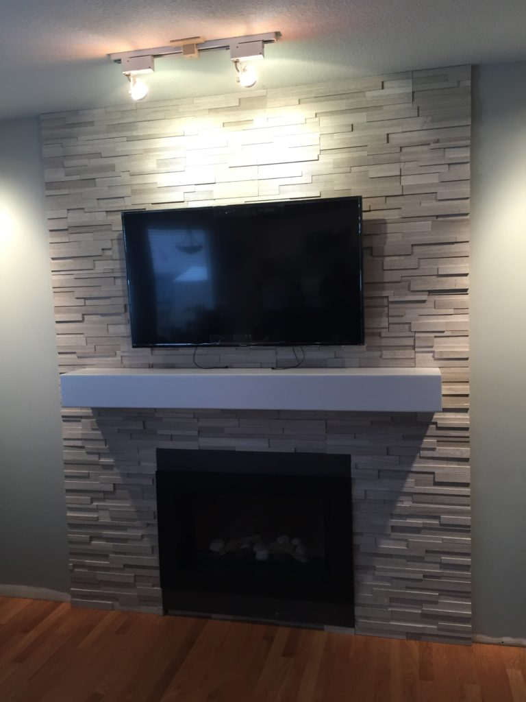 renovated basement with fireplace