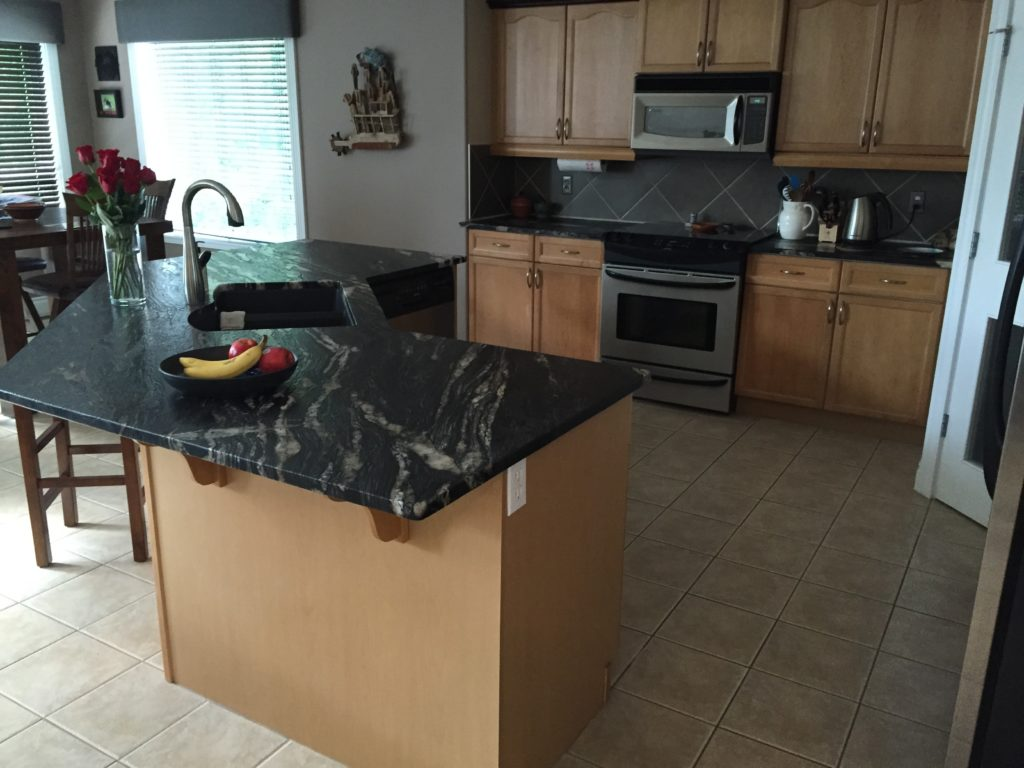 kitchen with black counter top