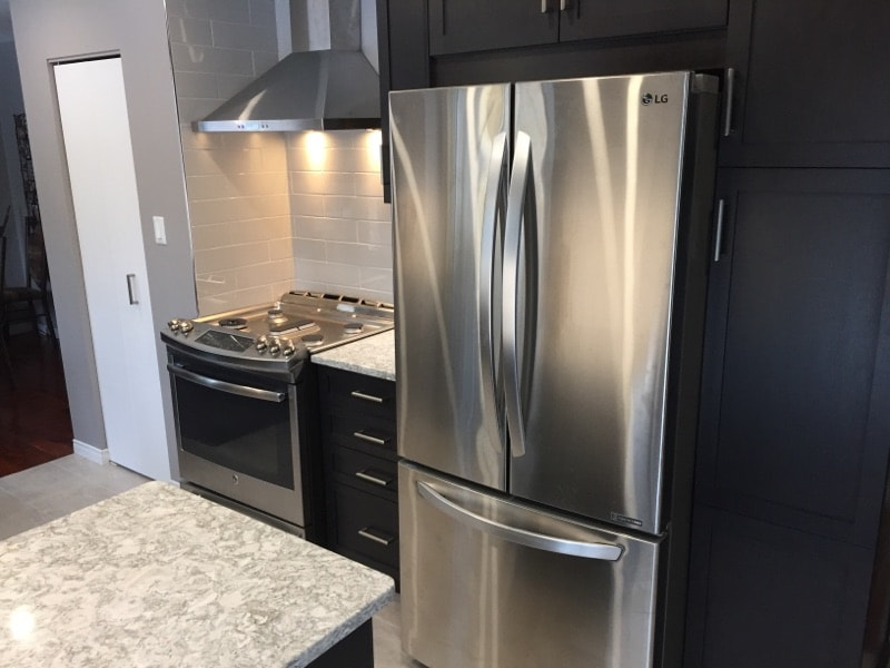 renovated kitchen with new fridge