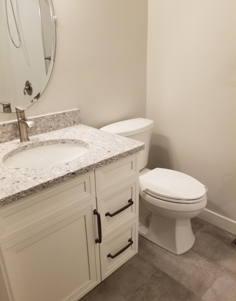 sink and toilet in renovated bathroom
